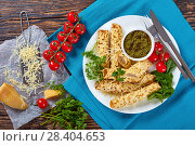 crepes stuffed with chicken meat on plate. Стоковое фото, фотограф Oksana Zh / Фотобанк Лори