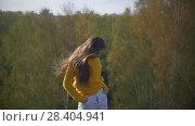 Купить «Portrait of happy woman with long hair smiling in the forest», видеоролик № 28404941, снято 18 августа 2019 г. (c) Константин Шишкин / Фотобанк Лори