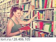 Купить «Teenagers holding book and reading new literature», фото № 28406105, снято 16 сентября 2016 г. (c) Яков Филимонов / Фотобанк Лори