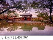 Купить «Phoenix Hall, Hoodo or Amida Hall, of Byodo-in, Jodo-shiki garden with a pond in a beautiful surreal sunrise autumn scenery framed by Japanese maple tree...», фото № 28407961, снято 21 ноября 2017 г. (c) age Fotostock / Фотобанк Лори