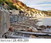 Cala d'Hort beach and boat garages. Ibiza Island, Balearic Islands. Spain (2018 год). Стоковое фото, фотограф Alexander Tihonovs / Фотобанк Лори