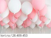 Купить «Colourful balloons, pink, white, streamers. Helium Ballon floating in birthday party. Concept balloon of love and valentine», фото № 28409453, снято 1 мая 2018 г. (c) Сергей Тимофеев / Фотобанк Лори