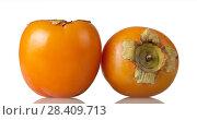 Купить «Persimmon, two large orange fruits isolated on white», фото № 28409713, снято 20 декабря 2017 г. (c) Сергей Молодиков / Фотобанк Лори