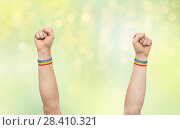 Купить «hands with gay pride rainbow wristbands shows fist», фото № 28410321, снято 2 ноября 2017 г. (c) Syda Productions / Фотобанк Лори