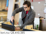 Купить «assembler with screwdriver making furniture», фото № 28410385, снято 10 ноября 2017 г. (c) Syda Productions / Фотобанк Лори