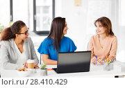 Купить «businesswomen with laptop working at office», фото № 28410429, снято 17 марта 2018 г. (c) Syda Productions / Фотобанк Лори