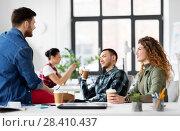 Купить «creative team drinking coffee at office», фото № 28410437, снято 1 апреля 2018 г. (c) Syda Productions / Фотобанк Лори