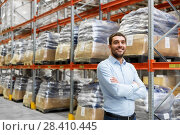 Купить «happy businessman at warehouse», фото № 28410445, снято 9 декабря 2015 г. (c) Syda Productions / Фотобанк Лори