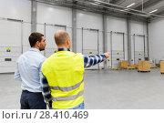 Купить «businessman showing warehouse to worker», фото № 28410469, снято 9 декабря 2015 г. (c) Syda Productions / Фотобанк Лори