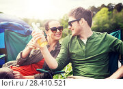 Купить «happy couple clinking drinks at campsite tent», фото № 28410521, снято 27 мая 2016 г. (c) Syda Productions / Фотобанк Лори