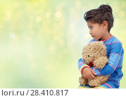 Купить «sad little girl with teddy bear over green lights», фото № 28410817, снято 25 августа 2013 г. (c) Syda Productions / Фотобанк Лори