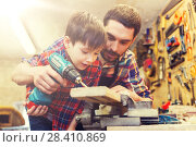 Купить «father and son with drill working at workshop», фото № 28410869, снято 14 мая 2016 г. (c) Syda Productions / Фотобанк Лори