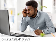 Купить «businessman with computer and papers at office», фото № 28410989, снято 7 апреля 2018 г. (c) Syda Productions / Фотобанк Лори
