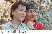 Купить «Elderly mother and her adult daughter», видеоролик № 28411597, снято 2 мая 2018 г. (c) Илья Шаматура / Фотобанк Лори