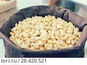Купить «Image of white cashew in container», фото № 28420521, снято 4 сентября 2017 г. (c) Яков Филимонов / Фотобанк Лори