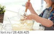 Купить «Little girl baker puts the ingredients for kneading the dough», видеоролик № 28426425, снято 27 мая 2020 г. (c) Константин Шишкин / Фотобанк Лори