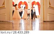 Купить «Ladies with cavaliers in vintage costumes dancing waltz», фото № 28433289, снято 24 мая 2018 г. (c) Константин Шишкин / Фотобанк Лори