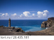 Portugal, Azores, Faial Island, Capelinhos, Capelinhos Volcanic Eruption Site, elevated view of site and lighthouse. Стоковое фото, фотограф Walter Bibikow / age Fotostock / Фотобанк Лори