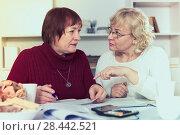 Купить «serious mature females with communal payments», фото № 28442521, снято 22 ноября 2017 г. (c) Яков Филимонов / Фотобанк Лори
