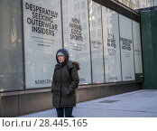 Купить «Signage on the windows of the future home of a Nordstrom Men's shop in Midtown Manhattan in New York on Sunday, January 14, 2018 advertises that it is hiring, preparing for its imminent opening.», фото № 28445165, снято 14 января 2018 г. (c) age Fotostock / Фотобанк Лори