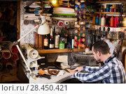 Купить «Male worker stitching new belt», фото № 28450421, снято 23 июля 2018 г. (c) Яков Филимонов / Фотобанк Лори
