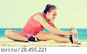Купить «Happy young sportwoman training gymnastics», фото № 28455221, снято 23 января 2019 г. (c) Яков Филимонов / Фотобанк Лори