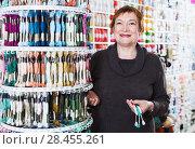 Купить «Woman choosing mouline for embroidery in needlework shop», фото № 28455261, снято 10 мая 2017 г. (c) Яков Филимонов / Фотобанк Лори