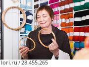 Купить «Senior female choosing embroidery hoops», фото № 28455265, снято 10 мая 2017 г. (c) Яков Филимонов / Фотобанк Лори