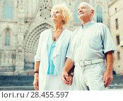 Купить «loving mature spouses enjoying walk», фото № 28455597, снято 27 августа 2017 г. (c) Яков Филимонов / Фотобанк Лори