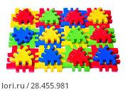 Купить «Детский разноцветный пластмассовый пазл конструктор на белом фоне», фото № 28455981, снято 25 января 2018 г. (c) Алёшина Оксана / Фотобанк Лори