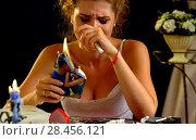 Купить «Broken heart woman. Couple break up. Burning family photo.», фото № 28456121, снято 10 июля 2020 г. (c) Gennadiy Poznyakov / Фотобанк Лори