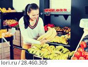 Купить «Woman choosing fruits in grocery shop», фото № 28460305, снято 23 ноября 2016 г. (c) Яков Филимонов / Фотобанк Лори