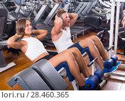 Купить «Well trained man and woman training abdominal muscles in gym», фото № 28460365, снято 16 ноября 2019 г. (c) Яков Филимонов / Фотобанк Лори