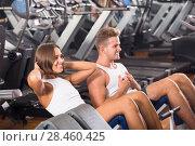 Купить «Well trained attractive young man and woman training abdominal muscles in gym», фото № 28460425, снято 4 октября 2016 г. (c) Яков Филимонов / Фотобанк Лори