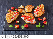 Купить «croissant sandwiches on a stone tray», фото № 28462305, снято 22 мая 2018 г. (c) Oksana Zh / Фотобанк Лори