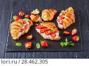 croissant sandwiches on a stone tray. Стоковое фото, фотограф Oksana Zh / Фотобанк Лори