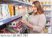Купить «Woman customer with assortment of grocery food shop», фото № 28467781, снято 11 апреля 2018 г. (c) Яков Филимонов / Фотобанк Лори