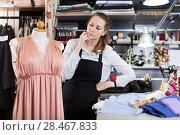 Купить «Female seamstress is thinking about new dress for collection of clothes near mannequin», фото № 28467833, снято 5 мая 2018 г. (c) Яков Филимонов / Фотобанк Лори