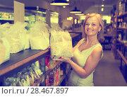 Купить «woman buying cereals in grocery store», фото № 28467897, снято 19 апреля 2019 г. (c) Яков Филимонов / Фотобанк Лори