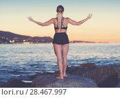 Купить «Female 24-31 years old is practicing stretching», фото № 28467997, снято 3 июля 2017 г. (c) Яков Филимонов / Фотобанк Лори