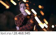 Купить «A man stands on the background of sparks from the grinder», видеоролик № 28468945, снято 21 ноября 2018 г. (c) Константин Шишкин / Фотобанк Лори