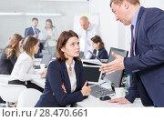Купить «Ordinary boss scolding female subordinate», фото № 28470661, снято 21 апреля 2018 г. (c) Яков Филимонов / Фотобанк Лори