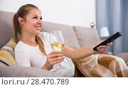 Girl is resting with wine and watching TV. Стоковое фото, фотограф Яков Филимонов / Фотобанк Лори