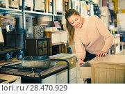 Купить «Woman choosing commode in the furniture shop», фото № 28470929, снято 15 ноября 2017 г. (c) Яков Филимонов / Фотобанк Лори