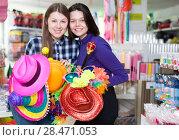 Купить «Girls in store of festival accessories», фото № 28471053, снято 15 марта 2018 г. (c) Яков Филимонов / Фотобанк Лори
