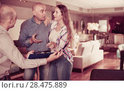 Купить «Couple shocked from looking through price-list», фото № 28475889, снято 16 мая 2017 г. (c) Яков Филимонов / Фотобанк Лори