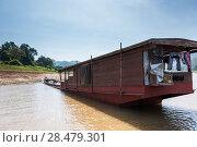 Houseboat in River Mekong, Laos (2016 год). Стоковое фото, фотограф Keith Levit / Ingram Publishing / Фотобанк Лори