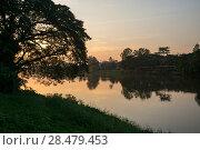 Silhouette of trees at riverside at sunset, Chiang Rai, Thailand. Стоковое фото, фотограф Keith Levit / Ingram Publishing / Фотобанк Лори