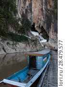 Купить «Tourboat in river, Pak Ou Caves, Pak Ou District, Luang Prabang, Laos», фото № 28479577, снято 14 декабря 2016 г. (c) Ingram Publishing / Фотобанк Лори