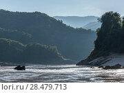 Купить «Scenic view of river with mountain range in background, River Mekong, Laos», фото № 28479713, снято 12 декабря 2016 г. (c) Ingram Publishing / Фотобанк Лори